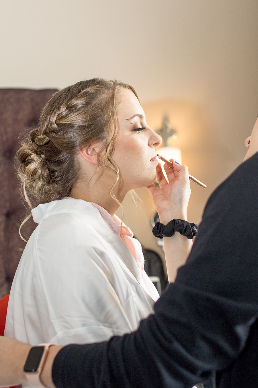 bride getting wedding makeup done at chubb hotel and conference center