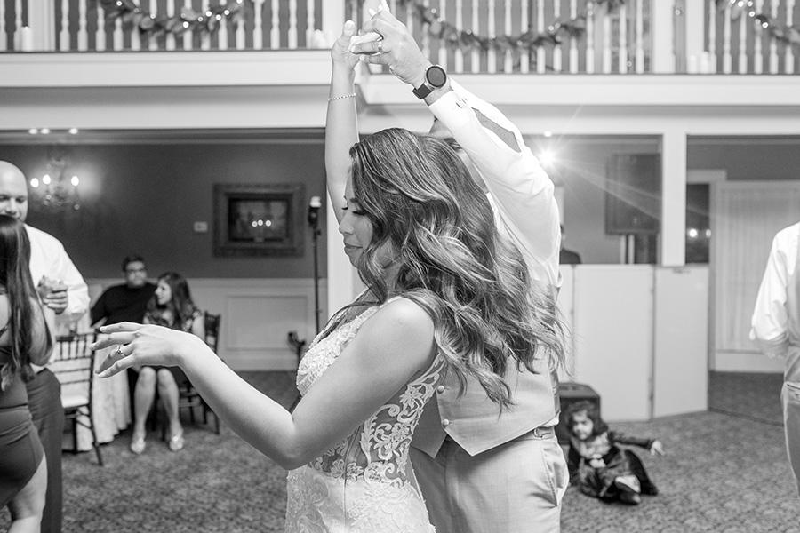 bride does a twirl at wedding reception