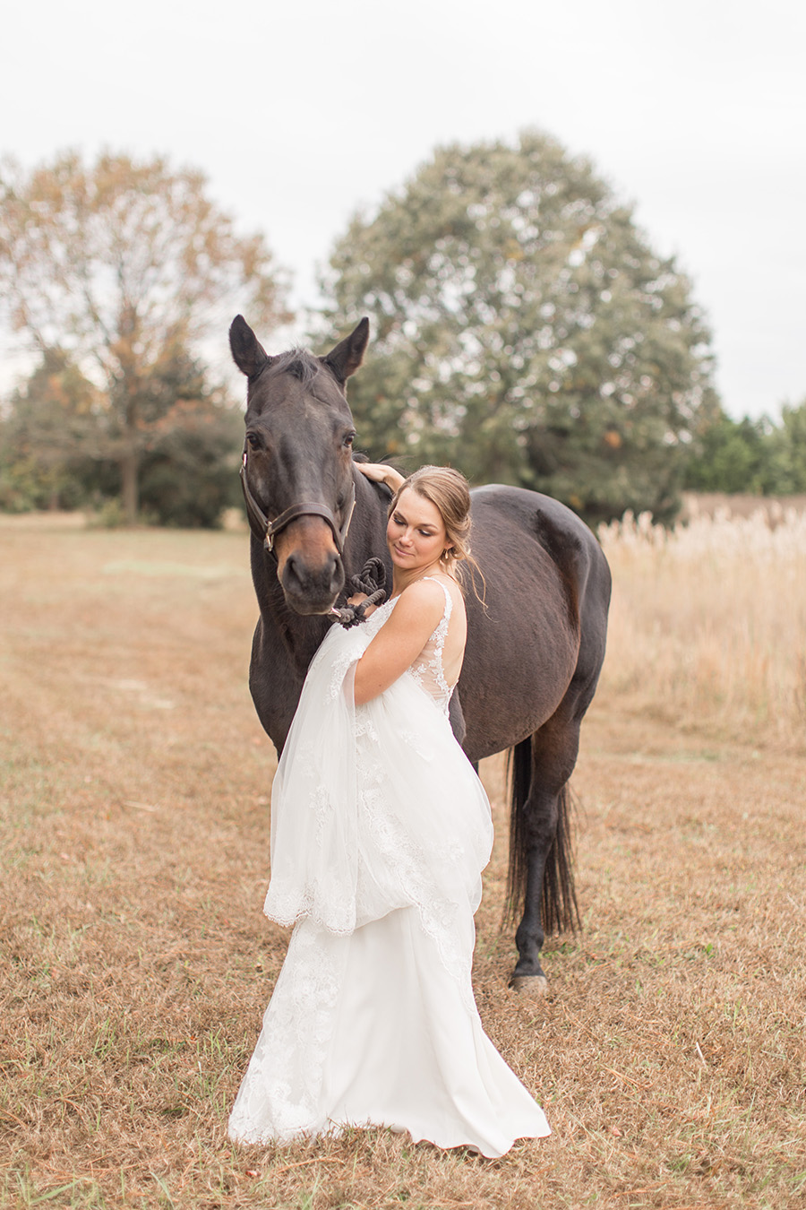 bride and her horse on her wedding day at Eagle Manor