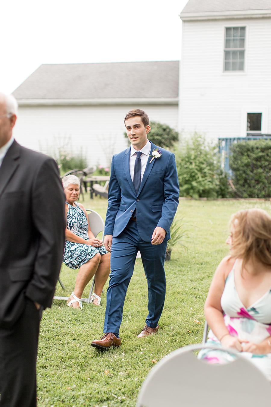groom walks up the aisle