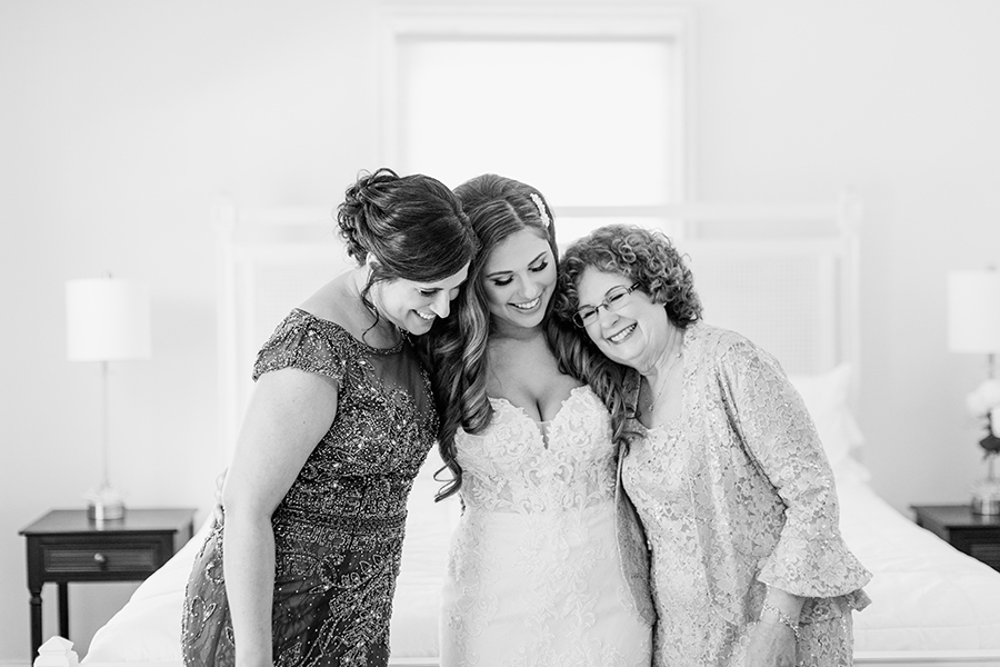bride with her mom and grandmom before the wedding