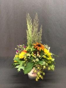 picture of seasonal arrangement on vintage vase