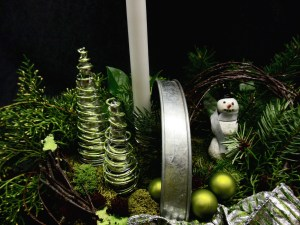 close up picture of winter scene in metal basket.