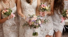 Wedding flowers, bride and bridesmaids holding their bouquets at wedding day. Happy wedding concept