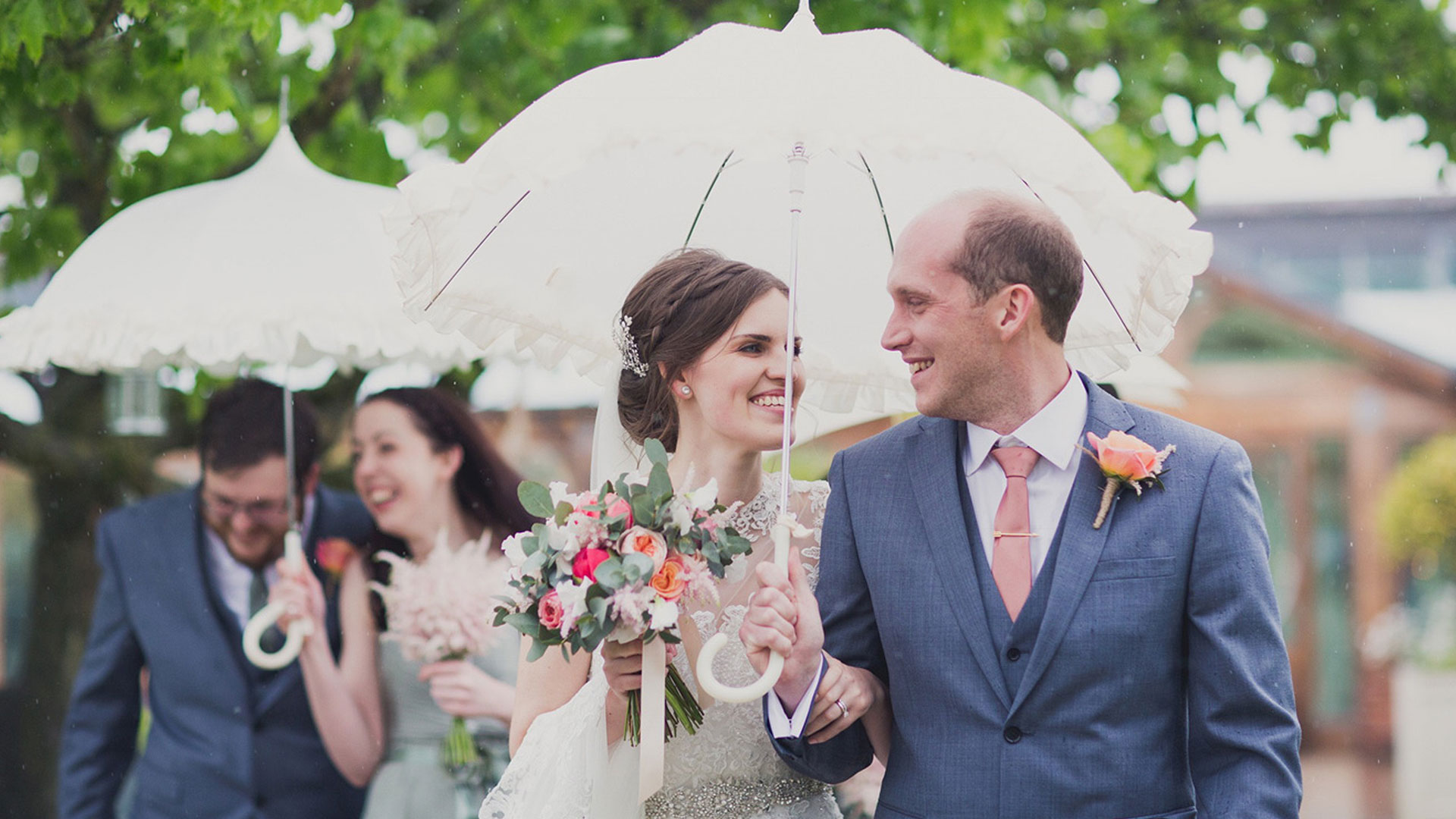bride-and-groom-vintage-wedding-umbrellas.jpg