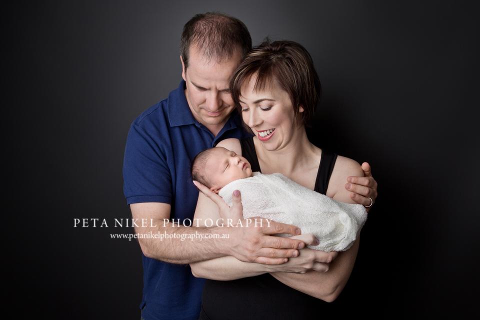 Newborn photo with parents Hobart Photographer