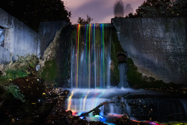 Colorful Long Exposure Photos of Glow Sticks Dropped Into Waterfalls glowwaterfall 4