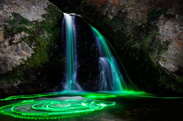 Colorful Long Exposure Photos of Glow Sticks Dropped Into Waterfalls glowwaterfall 5