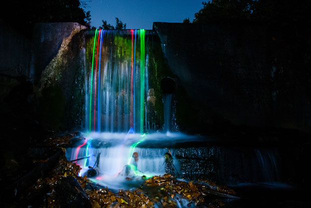 Colorful Long Exposure Photos of Glow Sticks Dropped Into Waterfalls glowwaterfall 6