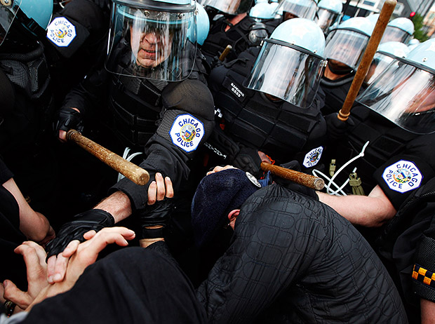 Interview with Andrew Nelles, Former Chicago Sun Times Photographer Protestors scuffle with Chicago Police during NATO Summit protests on E. Cermak Rd. in Chicago Ill. on Sunday May 20 2012. Protests turned violent on Sunday as protestors began to clash with police