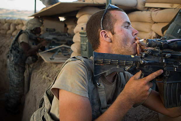 Interview with Andrew Nelles, Former Chicago Sun Times Photographer U.S. Army Pfc. Tyler McLaughlin of 1st Platoon Bravo Battery 2nd Battalion 321st Field Artillery 4th Brigade Combat Team 82nd Airborne Division prepares to return fire after being fire upon at