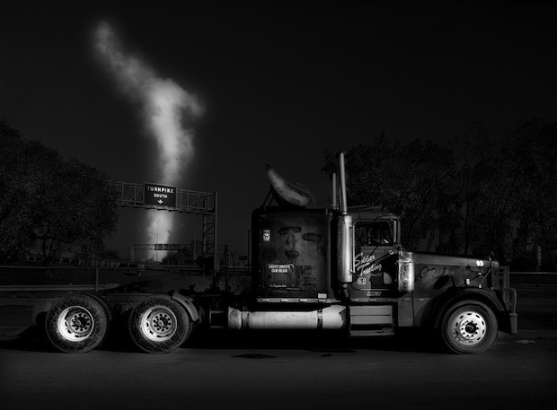 Black and White Night Photos of Dormant 18 Wheelers at Truck Stops blackdog