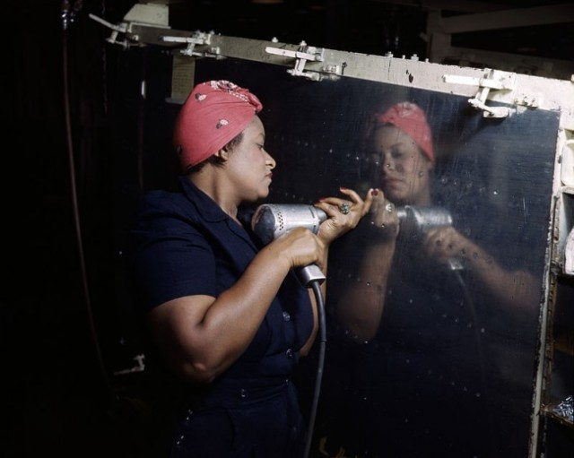 "A ""Rosie"" working on a A-31 Vengeance bomber, Nashville, TN 1943."