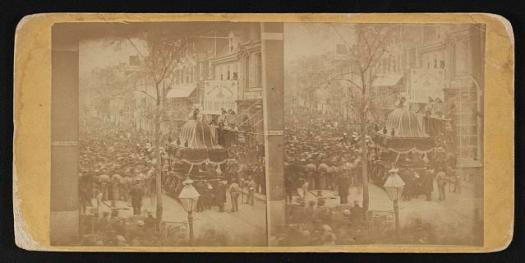 Photograph shows a procession following Abraham Lincoln's funeral car on the streets of Philadelphia, April 22, 1865.