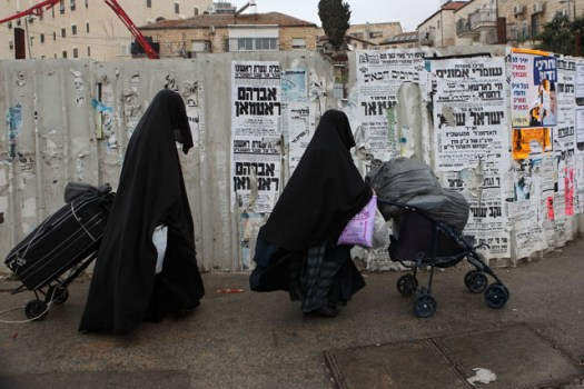 Extreme orthodox Jewish women wearing coverings from head to toe to keep their modesty and not attract men sexually.