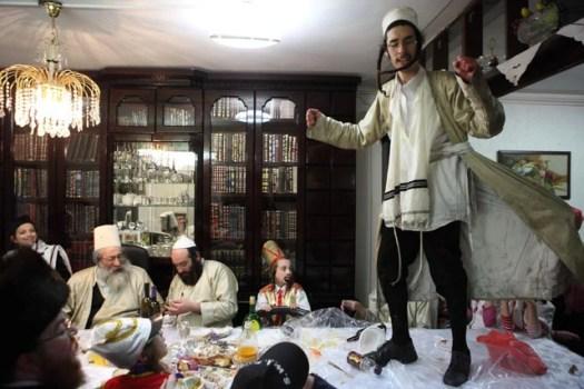 Hasidic Jews dancing at a table called 'Tish' at the Jewish holiday Purim.