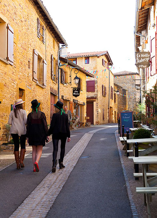 Strolling along a quiet street in Mâcon during the Fêtes des Conscrits.