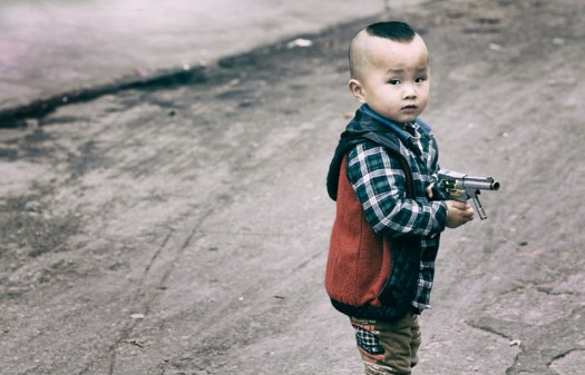 Boy with fake gun – Qingxi, China