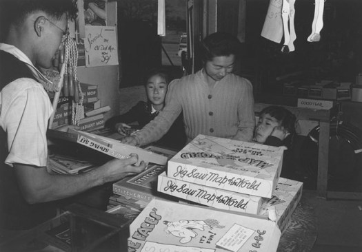 Mrs. Yaeko Nakamura and family buying toys with Fred Moriguchi.