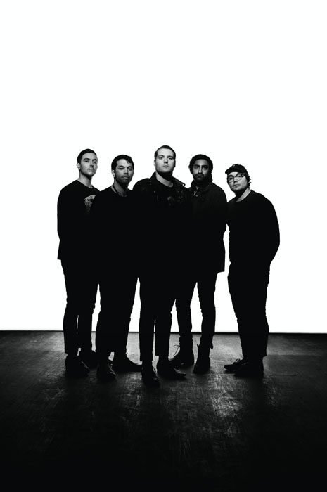 Portrait of band Deafheaven. Cactus RF60, modified with DIY barn doors and two unmodified lights on white sweep.