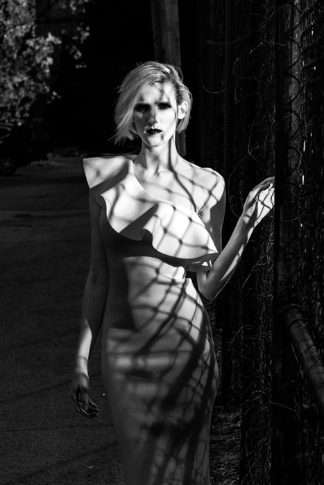 The shadows are crisp and create a dramatic effect on the model.
