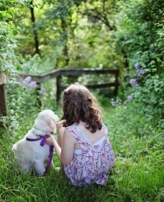 Girl training a puppy