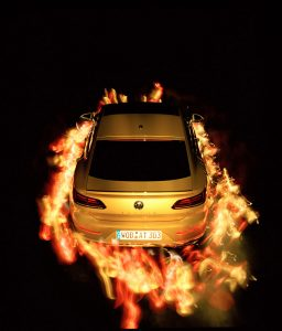 A Volkswagen car lit up from the light exposure.