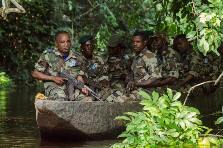 Eco guards tasked with protecting Kokoua National Park on patrol with automatic rifles. Photograph by conservation photographer Pete Oxford.