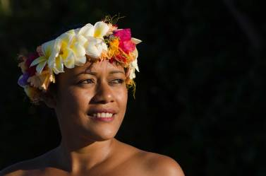 A local woman in Fiji is shown with a flower headdress. Photo by indigenous person photographer Pete Oxford.