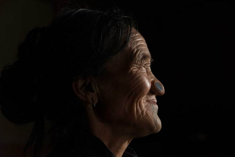 A native Apatani women is shown with her traditional nose plugs. Photo by conservation photographer and cultural photographer Pete Oxford.