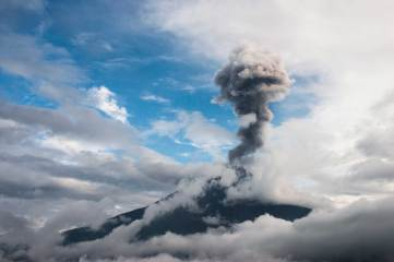 Tungurahua Volcano releases a large plume of ask and steam into the sky. Photo by conservation photographer and landscape photographer Pete Oxford.