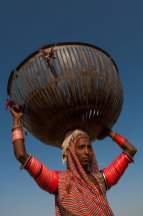 A gypsy woman carries a basket on her head. Photo by indigenous person photographer Pete Oxford.