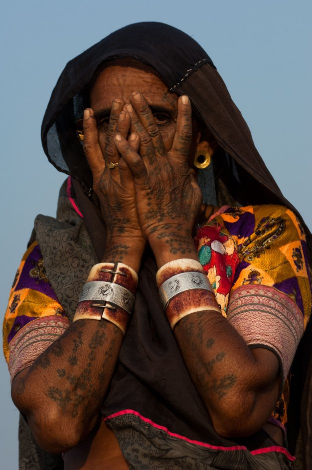 A Rabari woman displays her tattoos. Photo by indigenous person photographer Pete Oxford.