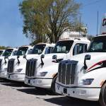 A lineup of Peterbilt Model 579s equipped with the SmartLINQ remote diagnostics system at TCW
