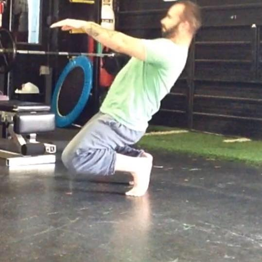 Peter Baker doing a sissy squat to help prevent knee pain