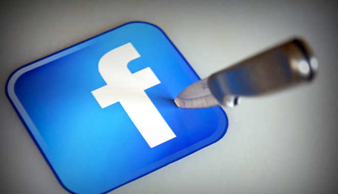 Facebook logo stabbed by a knife