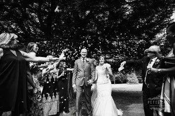 Documentary wedding photographer London confetti after church