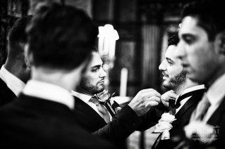 Documentary wedding photographer London bestman fixing tie