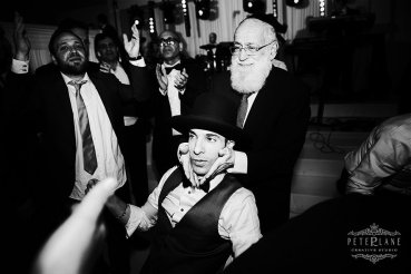 jewish wedding photographer - groom and rabby