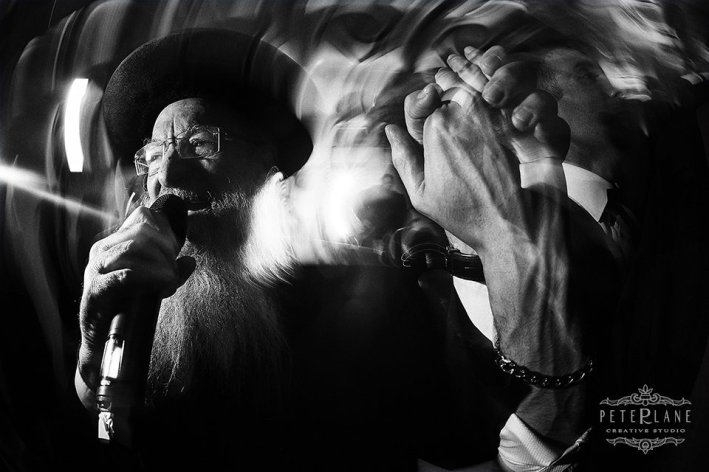 jewish wedding photographer London rabbi singing