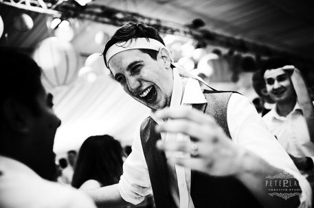 Jewish wedding photographer groom dancing