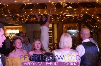 bride dancing on the table in the white hart