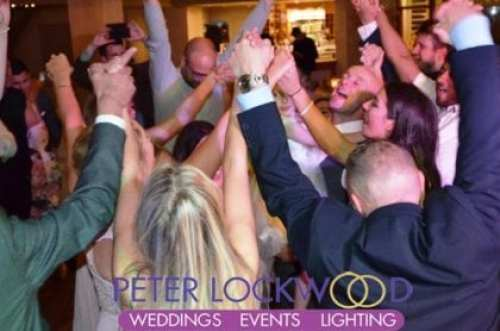 happy wedding guests in the oak room