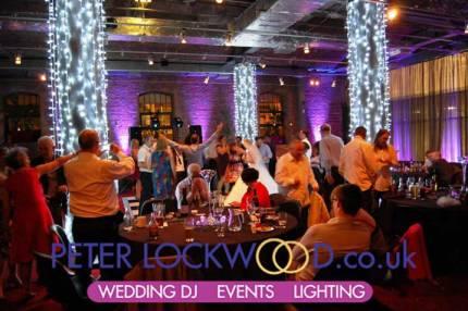 wedding-purple-mood-lighting-and-bright-white-pilar-lighting-by-peter-lockwood
