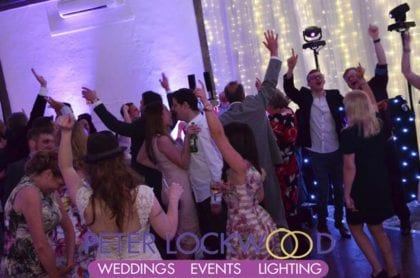 Shrigley Hall wedding guests with there hands in the air