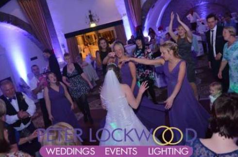 girls-and-the-bride-dancing-with-purple-wedding-lighting-in-the-tilden-suite-at-shrigley-hall-cheshire