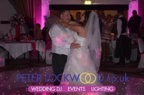wedding-first-dance-with-pink-uplighting-at-Shrigley-Hall-Hotel