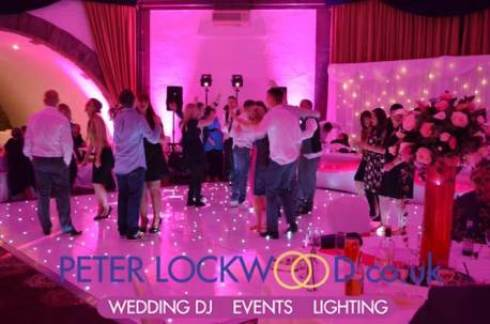 wedding-guests-dancing-in-pink-uplighting-at-Shrigley-Hall-Hotel