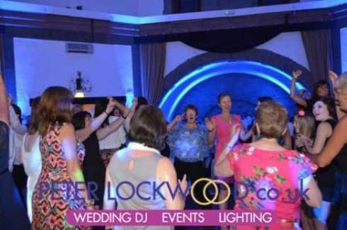 wedding-guests-with-blue-up-lighting-at-Shrigley-Hall-(Tilden-Suite)