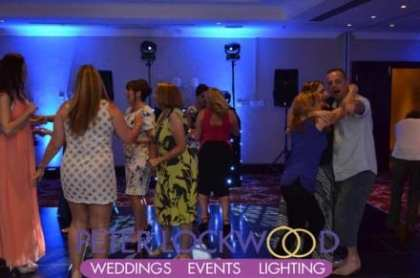 wedding-guests-dancing-the-night-away-on-the-dancefloor-in-the-midle-of-the-worsley-suite-at-worsley-marriott